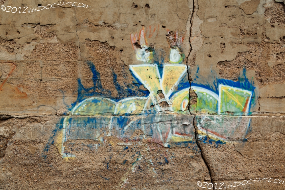 Detail of graffiti on center of wall.