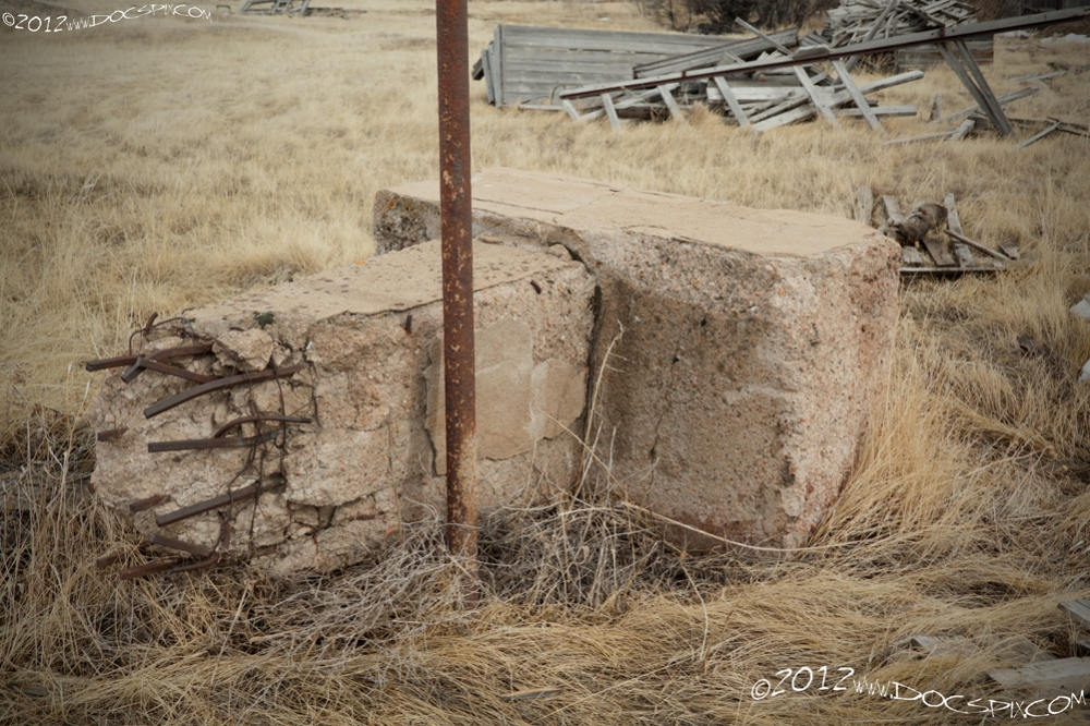 One of the top posts from one of the stills and a fence post rest near Cedar Street.