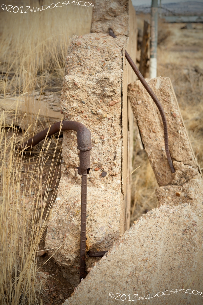 "A pipe is ""connected"" to a piece of rebar from the original still wall."