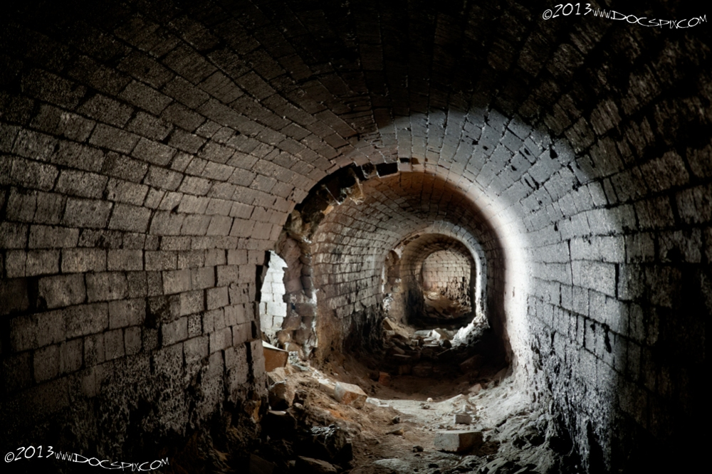 A view of the last three flues. Although the tunnels were made of brick, the tremendous heat generated glazed the surface of the brick. There was probably some hot oil that was included in the exhaust; note the lower portions of the walls have bricks that appear to be melted.