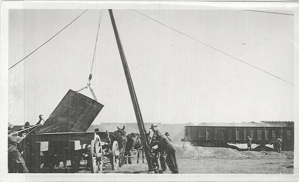 A crane is used to lift one of the panels that would be used for one of the storage tanks.