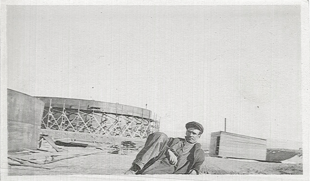 An unidentified worker takes a break near the tank farm as its being constructed.